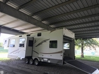 Fully Expandable With Drop Down Bunks And ATV Storage Area.