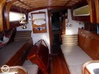 Spacious Cabin Showing Table Secured For Passage.